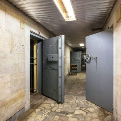 Corridor With Open Armored Doors In An Abandoned F 84HZAN5 Min Scaled
